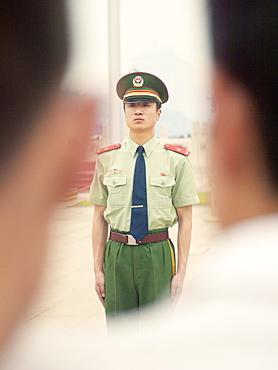 Policeman on guard, Tiananmen Square, Beijing, China, Asia