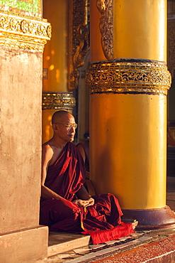 Monk meditating at Shwedagon Pagoda, Yangon (Rangoon), Myanmar (Burma), Asia