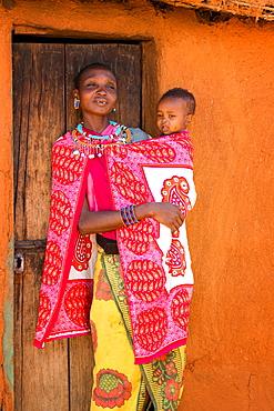 African Masai woman and baby, Masai Mara, Kenya, East Africa, Africa