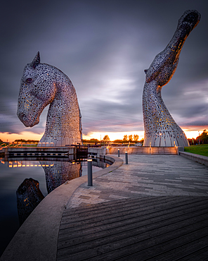 The Kelpies at sunset, Forth and Clyde Canal at Helix Park, Falkirk, Stirlingshire, Scotland, United Kingdom, Europe