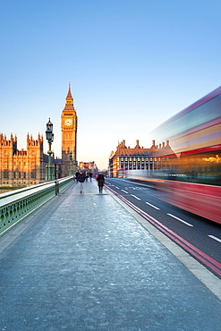 Red double-decker bus on Westminster Bridge, in front of Big Ben and the Palace of Westminster, London, England, United Kingdom, Europe