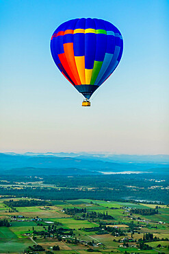 Hot air balloon over Auburns farmland, Washington State, United States of America, North America