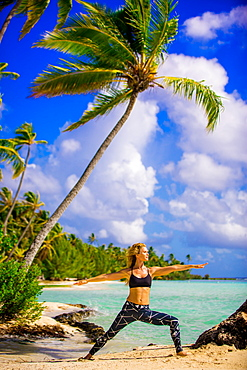 Woman doing yoga, Le Taha'a Resort, Tahiti, French Polynesia, South Pacific, Pacific
