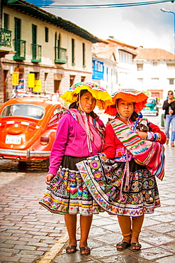 Two Cholita Peruvian girls and their lambs, Cusco, Peru, South America