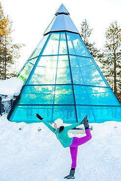 Woman doing yoga, glass teepee, Kakslauttanen Igloo Village, Saariselka, Finland, Scandinavia, Europe