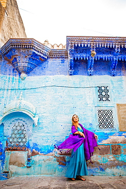 Laura Grier stands in the blue streets of Jodhpur, the Blue City, Rajasthan, India, Asia