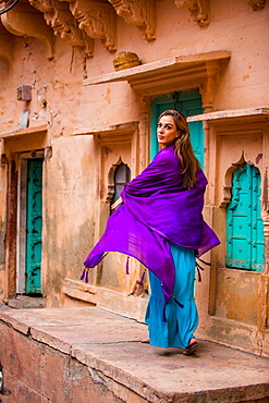 Laura Grier walking through the old streets in Jodhpur, the Blue City, Rajasthan, India, Asia
