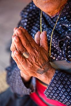Old woman's hands praying, Bhaktapur, Nepal, Asia