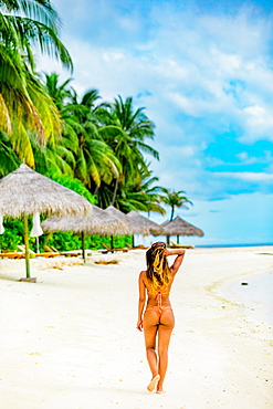 Scenic at Maldives Island with model, Maldives, Indian Ocean, Asia