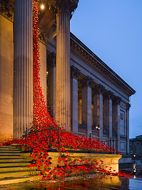 Poppies Weeping Window cascades down the front facade of St. George's Hall in Liverpool marking 100 year anniversary of WW1, Liverpool, Merseyside, England, United Kingdom, Europe