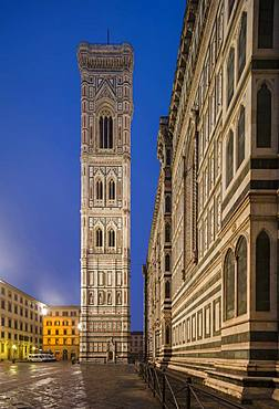 Looking to the Campanile along the side of the Cathedral (Duomo) (Santa Maria Del Fiore) in the early morning, Florence, UNESCO World Heritage Site, Tuscany, Italy, Europe