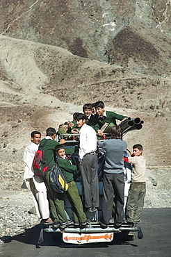 Children overload a local bus to get to school , Gilgit-Baltistan, Pakistan, Asia