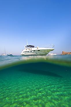 A speedboat moored at San Blas Bay off the island of Gozo near Malta, Mediterranean, Europe