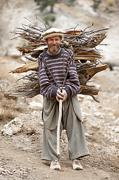 A Kalasha man carrying firewood, Kalasha valley, Chitral, North West Frontier Province, Pakistan, Asia