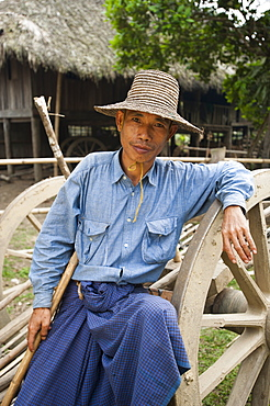 A farmer takes a break and rests on his bull cart in Myanmar (Burma), Asia