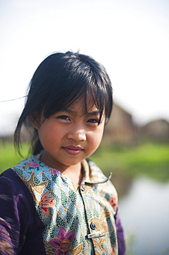 A little girl living in a floating village on Inle Lake in Myanmar (Burma), Asia