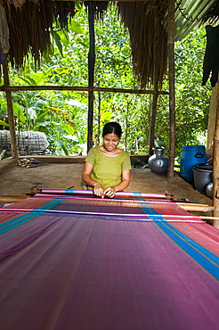 A woman weaves traditional fabric using a hand loom, Chittagong Hill Tracts, Bangladesh, Asia
