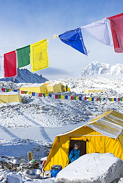 Prayer flags and the Everest base camp at the end of the Khumbu glacier that lies at 5350m, Himalayas, Nepal, Asia
