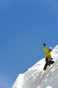 A climber practises on an ice wall in preparation for climbing Everest, Khumbu Region, Nepal, Asia