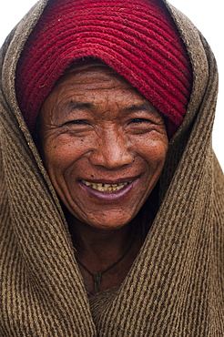 Woolen blankets are used like coats to keep warm in Nepal, Asia