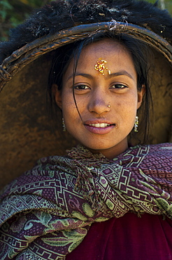 A striking looking woman from the remote Dolpa region carrying her rice pan on her head, Dolpa, Nepal, Asia