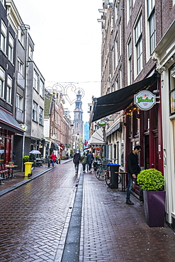 Jordaan district with the spire of Westerkerk beyond, Amsterdam, Netherlands, Europe
