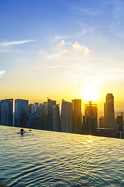 Infinity pool on the roof of the Marina Bay Sands Hotel with spectacular views over the Singapore skyline at sunset, Singapore, Southeast Asia, Asia