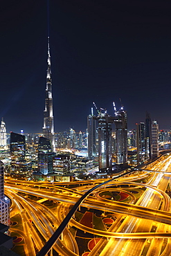 Dubai skyline and Sheikh Zayed Road Interchange by night, Dubai, United Arab Emirates, Middle East