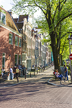 Old gabled buildings by a canal, Amsterdam, North Holland, The Netherlands, Europe