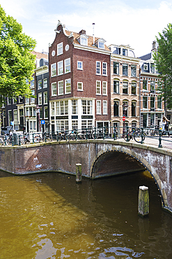 Old gabled buildings by a bridge on Keizersgracht, Amsterdam, North Holland, The Netherlands, Europe