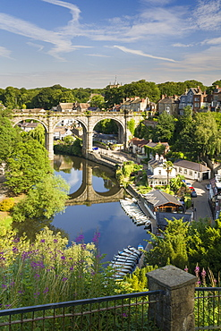 Rowing boats and viaduct over the River Nidd in lower Nidderdale on a mid-summer sunny day, Knaresborough, Borough of Harrogate, North Yorkshire, England, United Kingdom, Europe