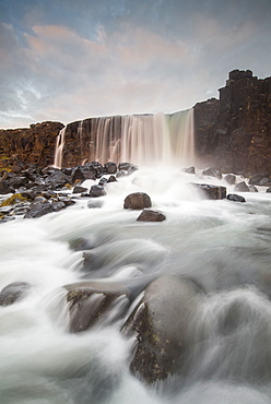 Oxarafoss waterfall at sunrise in Thingvellir National Park, UNESCO World Heritage Site, Iceland, Polar Regions