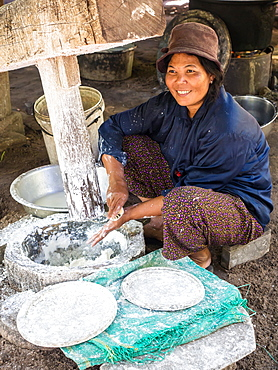 Woman using a large wooden press to make dough for noodles, village near Siem Reap, Cambodia, Indochina, Southeast Asia, Asia