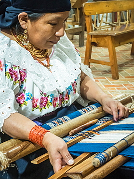 Indigenous woman weaving with backstrap loom, Otavalo, Ecuador, South America