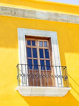 White window of yellow house, Oaxaca, Mexico, North America