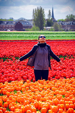 Young woman at tulip fields in Lisse, Netherlands, Europe