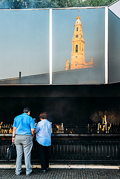 Religious pilgrims light candles at Sanctuary of Fatima (Basilica of Our Lady of Fatima), Portugal, Europe
