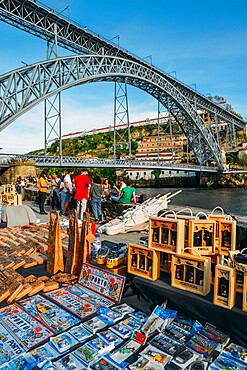 Souvenirs for sale at Cais Ribeira overlooking the Dom Luis I bridge in Porto, Portugal - UNESCO World Heritage Site