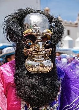Masked dancer in traditional costume, Fiesta de la Virgen de la Candelaria, Copacabana, La Paz Department, Bolivia, South America