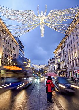 Regent Street with Christmas illuminations at twilight, London, England, United Kingdom, Europe