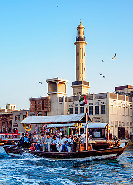 Abra Boat on Dubai Creek, Bur Dubai Grand Mosque in the background, Dubai, United Arab Emirates, Middle East
