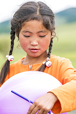 Portrait of a Mongolian Nomadic girl with braids, North Hangay province, Mongolia, Central Asia, Asia