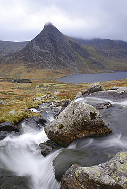 Water cascading down a fall on the Afon Lloer, overlooking the Ogwen Valley and Tryfan in the Glyderau mountain range, Snowdonia, Wales, United Kingdom, Europe - 1255-2