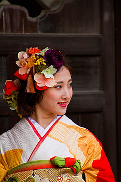 Japanese woman dressed in traditional kimono, Kyoto, Japan, Asia