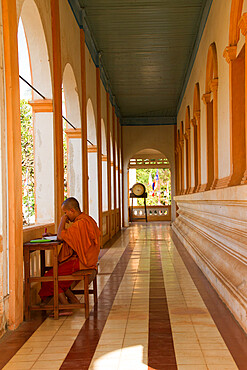 A Buddhist monk studies scripture in his temple of Wat Damnak, Siem Reap, Cambodia, Indochina, Southeast Asia, Asia