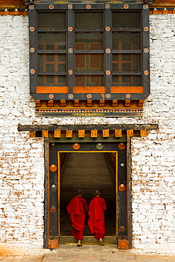 The Punakha Fortress and Buddhist monks, Paro, Bhutan, Asia