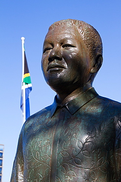 Nelson Mandela statue with South African flag, the Waterfront of Cape Town, South Africa, Africa