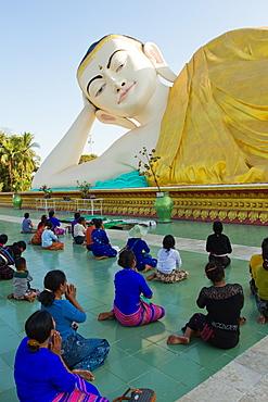 Reclining Buddha and Buddhist devotees, Bagan (Pagan), Myanmar (Burma), Asia