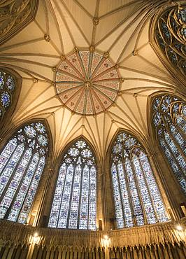 The decorative Chapter House ceiling and its stained glass windows inside York Minster, York, North Yorkshire, England, United Kingdom, Europe