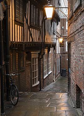 Antiquated timber fronted buildings and narrow street (alleyway), York, North Yorkshire, England, United Kingdom, Europe